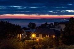Street light, houses and sea view at sunset in Seattle, USA royalty free stock photo