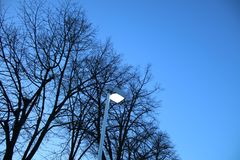 The street light illuminated on a beautiful morning stock image