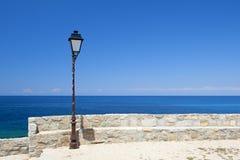 Street light by the Mediterranean Sea Royalty Free Stock Photos