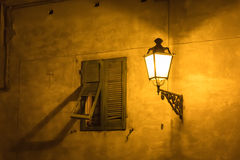 Street Light near old window, Italy Stock Photo