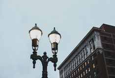 Street light at night with building behind stock photo