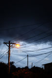 Street light at night with a stormy sky background Stock Photography