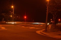 Street Light Painting. Slowing down time by using long exposure to catch vehicles lights driving by Stock Photography