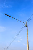 Street light pole with a blue sky Stock Images