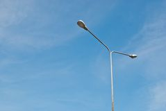 Street light pole on a sunny day Stock Images
