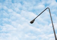 Street light pole under the couldy sky. Stock Photo