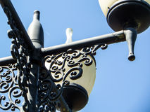 Street light post with four lamps and blue sky Stock Images