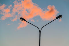 Street light and red cloud. Street light and the red cloud in the evening sky at sunsetn Royalty Free Stock Images
