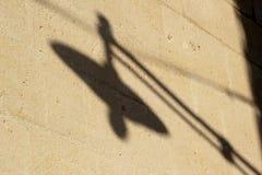 Street light shadow. Shadow of a street light on sun baked wall Royalty Free Stock Photos