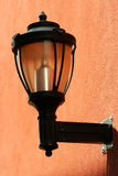 Street light on the side of a building Royalty Free Stock Photos