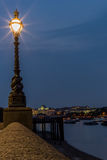 Street light on the side of the Thames in London Stock Images