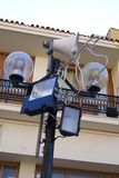 Street light, spotlights, and public address system. Street light, spotlights, and a public speaker audio system located in the courtyard of Chania Cathedral in Royalty Free Stock Images