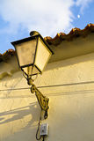 Street light on stone wall, spain. Stock Photo