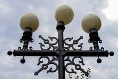 Street light. Triple lantern. Lamp. stock image
