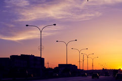 Street Light Units. Street lights off by the sunset in Amman,Jordan Stock Images