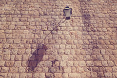 Street light on a wall Stock Images