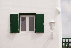 Street light and window to the white building. Typical of the architecture of Greece Stock Photos