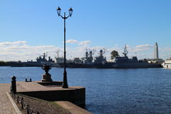 Street lighting and battle cruisers in Kronstadt. Russia Royalty Free Stock Images