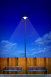 Street lighting with bench Stock Photography