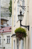 Street lighting and floral decorations. Estonia-Tallinn Old Town-Street Lighting And Floral Decoration Royalty Free Stock Image