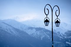 Street Lighting in mountain village in background of mountains slopes royalty free stock photography
