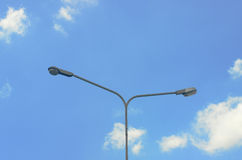 Street lighting poles. Light poles and public lighting stock photography