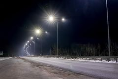 Street lighting, supports for ceilings with led lamps. concept of modernization and maintenance of lamps, place for text, night. royalty free stock photo