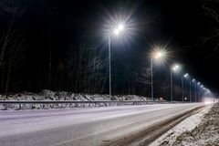 Street lighting, supports for ceilings with led lamps. concept of modernization and maintenance of lamps, place for text, night. royalty free stock image