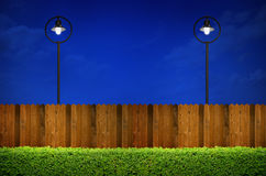 Street lighting and wooden fence Royalty Free Stock Photo