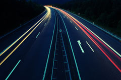 Street lights. Lights of cars during a night on a higway Stock Photography