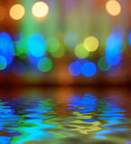 Street lights bokeh background reflection in water Royalty Free Stock Images