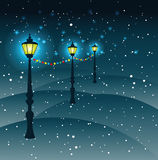 Street lights Christmas decorations in snowfall, vector. Street lights Christmas decorationsin snowfall,vector,greeting card Royalty Free Stock Photography