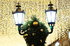 Street lights and Christmas decorations under bright lights royalty free stock photography