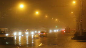 Street lights of city in fog and cars on way. stock video footage