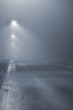 Street lights, foggy misty night, lamp post lanterns, deserted Stock Photo