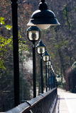 Street lights lining bridge Royalty Free Stock Photo