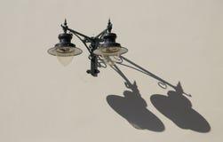 Street lights and long shadows Royalty Free Stock Image