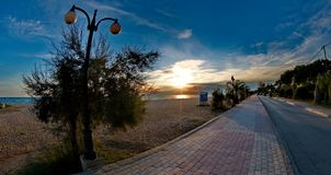 Street lights near a beach. A picture of street lights near a beach,in an empty rolad in a small town in Greece,Nea Moudania, in an area called halkidiki Stock Photos