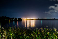 Street lights over water. Royalty Free Stock Image
