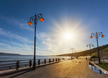 Street lights on the promenade of great river Stock Images