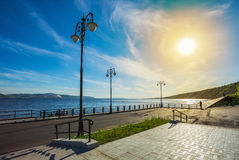 Street lights on the promenade of great river Royalty Free Stock Images