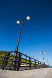 Street lights on the promenade of great river Stock Image