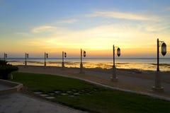 Street lights on the seafront. Sea over sunrise Stock Photo