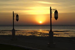 Street lights on the seafront. Sea over sunrise Royalty Free Stock Photography