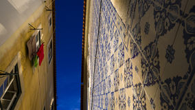 Street in Lisboa with tiles on the wall and blue sky above Royalty Free Stock Photography