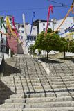 A street in Lisbon decorated with colored garlands royalty free stock image