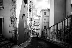 Among the street in Lisbon. Hill in lisbon in black and white Stock Photos