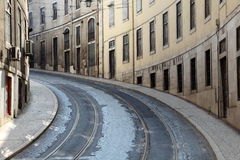 Street in Lisbon, Portugal. Street with tramway rails in Lisbon, Portugal Royalty Free Stock Image