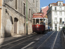 Street in Lisbon with tram car passing Royalty Free Stock Image