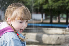 On the street a little enthusiastic girl standing with her mouth Stock Images